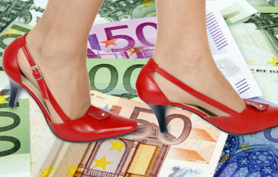 Red high hills shoes and money background